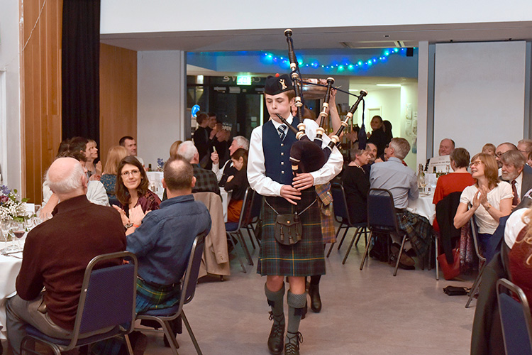 Grassmarket Community Project Burns Supper, piping in the haggis,