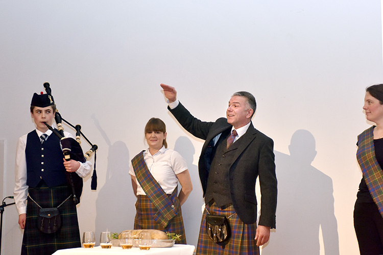 Grassmarket Community Project Burns Supper event photography, addressing in the haggis
