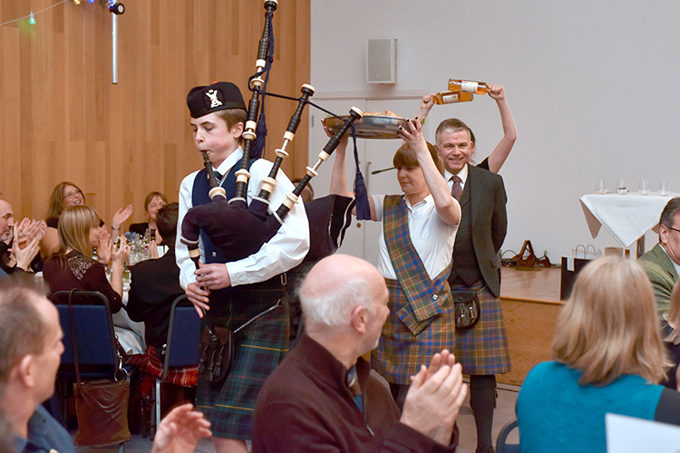 Grassmarket Community Project Burns Supper, piping in the haggis