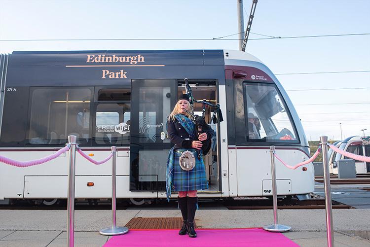 Bagpiper and Edinburgh Tram