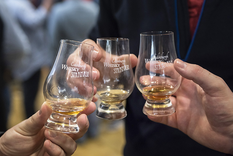 people with whisky glasses close up, Edinburgh Whisky Stramash 2019 event photographs